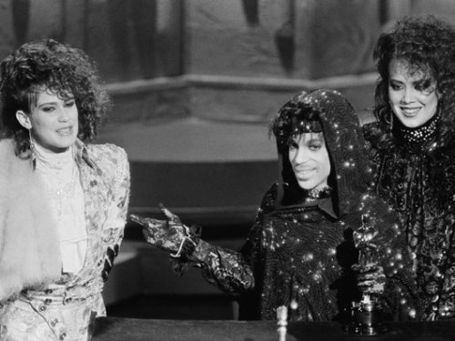 Prince accepting the 1985 Oscar for Best Original Song Score for Purple Rain with Wendy & Lisa.