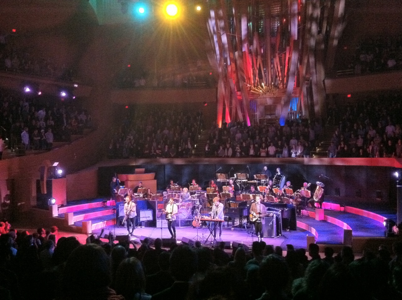 Local Natives at Walt Disney Concert Hall featuring a 23-piece orchestra Tonight was fantastic. I'd never been inside the Frank Gehry-designed building before tonight. The concert hall was much smaller and intimate than I anticipated, creating a wonderful atmosphere for this one-off performance. They started out backed by a four-piece string quartet playing Wide Eyes, Warning Sign (Talking Heads cover), Cubism Dream, Cards & Quarters, Careful (Television cover), Camera Talk and Sticky Thread. After an intermission they returned with the full 23-piece orchestra for Stranger Things, Shape Shifter, World News, Airplanes, Who Knows Who Cares, and encored with Sun Hands.* I'm so glad that guitarist/singer Taylor Rice got to achieve his dream of playing WDCH, just 2.5 years after visiting the space on an architecture class trip. *set list is from memory, there is likely a mistake or two