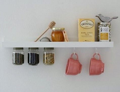 mildlyinterestingadventures:  Tea Shelf | Design*Sponge I just love this tea shelf, it's so clever. I have a very poky kitchen and bench space is very precious. So attaching jars to the bottom of the cupboards is a great idea, freeing up some of that bench space. Brilliant!
