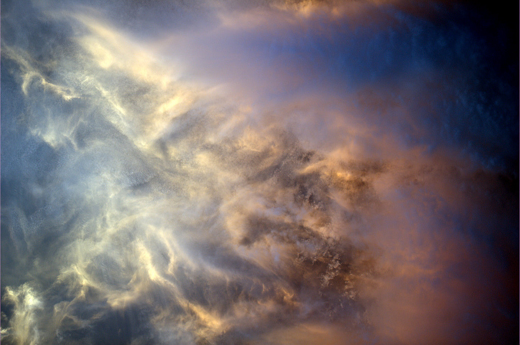 Clouds at sunset, viewed from the ISS. I love that there are people in space sending down gorgeous photos on a daily basis. #