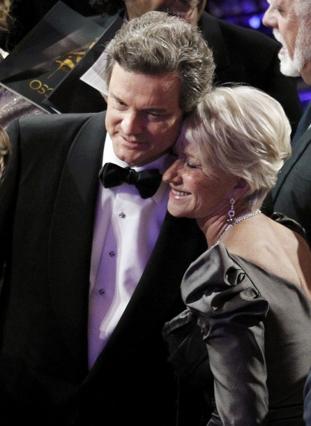 kingcolinthefirth:  callmecayce:  Colin Firth hugs Helen Mirren (via Photo from Reuters Pictures)  THE KING. THE QUEEN. OH SHIT JUST GOT REAL.