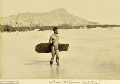 "blackandwtf:  1890 This is the first known photograph ever taken of a surfer. Surfing was  banned in Hawai'i by missionaries in the 1700s for its ""ungodliness,"" but  fortunately the Hawaiians didn't pay much heed to that decree."