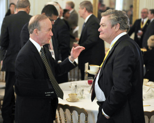 PHOTO OF THE DAY: Gov. Mitch Daniels, R-Ind., (left) shares some  thoughts with Gov. Jack Dalrymple, R-N.D., (right) prior to President Obama and Vice President Biden hosting a meeting with a bipartisan group of governors in the  State Dining Room of the White House on Monday. (Ron  Sachs-Pool/Getty Images)
