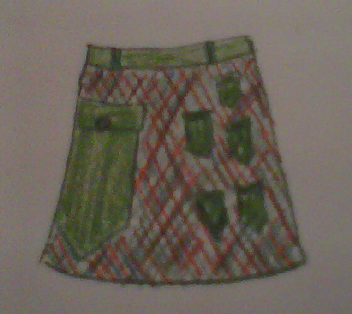 Whoa, this little mini-skirt is really cool. It's green, red, brown, blue flannel with one giant pocket on the right side and 5 little pockets on the left. My thought was this skirt would be perfect for someone who had 5 tiny items they want to carry as well as 1 larger item. For instance, 5 hairclips and 1 bike chain. OR 5 of those buttons you get at the MET and 1 travel magazine.