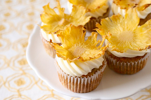 Deliciously tropical Hummingbird Cupcakes with  Cream Cheese icing, and Dried Pineapple flower topping Recipe at; Annie Eats