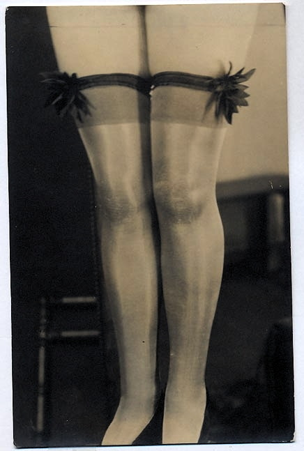 losteurope:  Vintage silk stockings with garters at top.