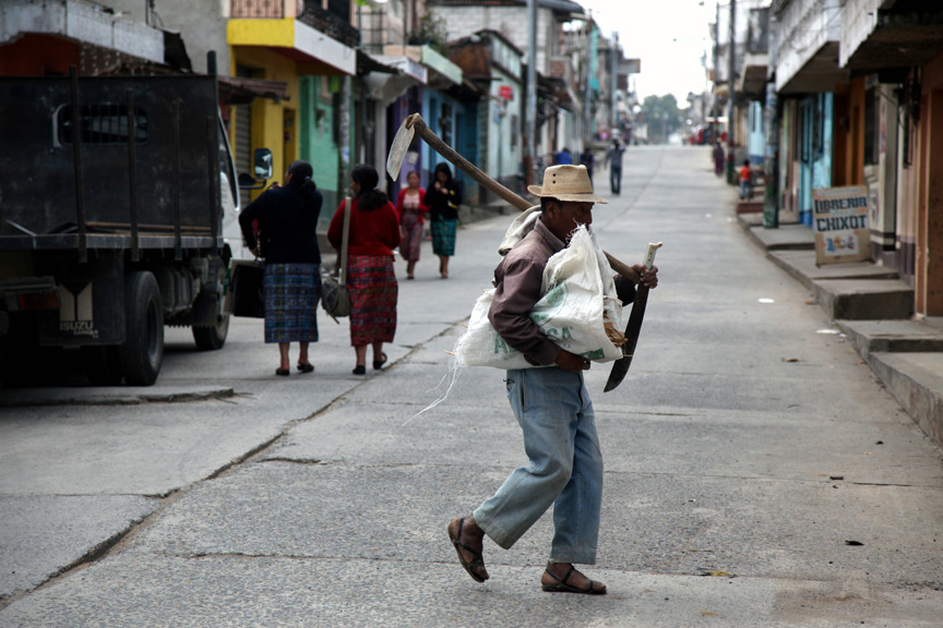 A typical image in Guatemala. Man walks with a machete on the streets of a town outside of Guatemala City.   Monday, Feb 28, 2011  Photo by Marcin Szczepanski, Multimedia Content Producer/CoE's Communications and Marketing