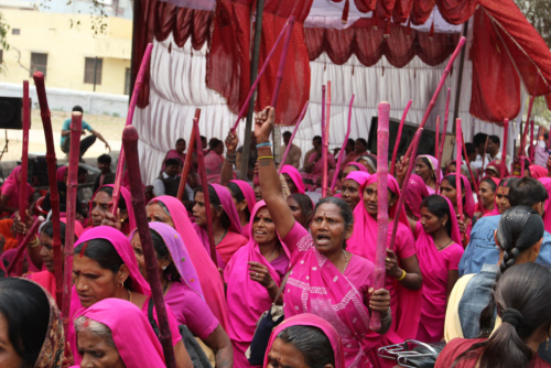 India's Pink Gang, the largest women's vigilante group in the world, shames abusive husbands and corrupt politicians by going door-to-door clad in electric pink saris and wielding sticks called laathis—the same sticks used by local cops when patrolling their beat. Recently, they've gained political clout by winning seats in the panchayat elections—the equivalent of American municipality elections.  Great piece from Amana Fontanella-Khan on India's pink gang—which happens to be the largest vigilante group in the world. (Photo by Fontanella-Khan)