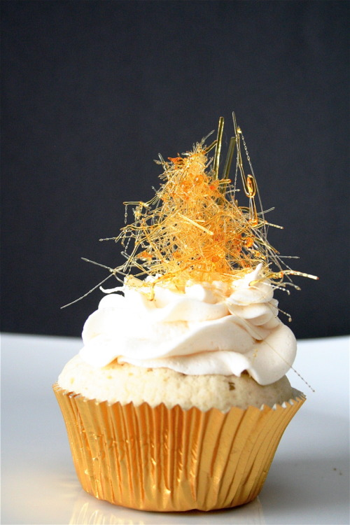 Want some Bubbly in your cupcakes? You're going to love this effervescent treat! Champagne Cupcakes with Champagne Buttercream and Spun Sugar Garnish. This is one lovely cupcake you can't pass up! Absolutely perfect for New Year's, or any special occasion! Get the recipe and more photos at The Curvy Carrot.