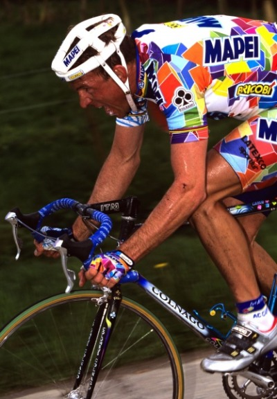 cadenced:  Johan Museeuw in the stand out/garish colours of Mapei. His victories included the Tour of Flanders (1993, 1995, 1998), Paris Roubaix (1996, 2000, 2002), Paris–Tours 1993 the Amstel Gold Race (1994) and the World Cup (1995, 1996). The photo taken by Graham Watson is part of a collection of his work covering the Tour of Flanders on VeloNews.