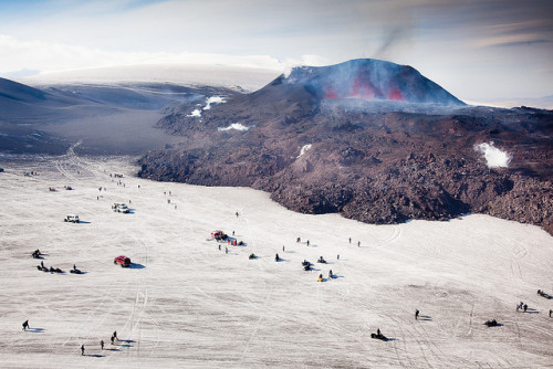 The eruption on Fimmvörðuháls last year. As you can see in this picture for us this is a perfect opportunity for a family trip up into the mountains. Photo by Kiddi Kristjáns