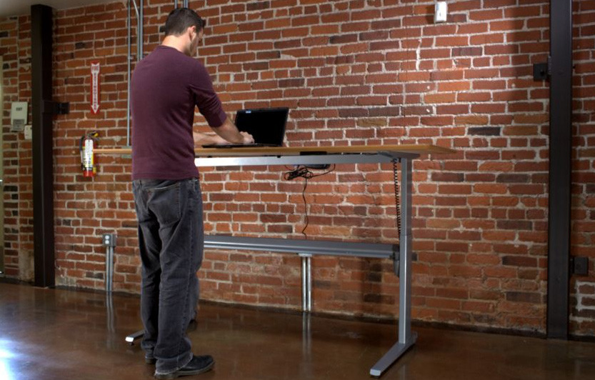 I'm a huge fan of standing desks because of the negative health effects of prolonged sitting. I have one (sort of, it's just an old industrial cart that's actually the perfect height with a perfectly placed footrest as well). I encourage everyone to use a standing desk. But why are they so ugly and uncool looking? This one is the best you can get. What would the ideal standing desk look like? And what features would it need to have for you to buy one?