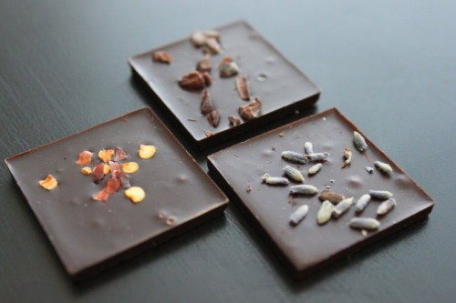 insertfood:  Sweet little chocolate pieces I got from Chocolarerie de la Nouvelle France. chocolate nibbs, pepper flakes and lavender.