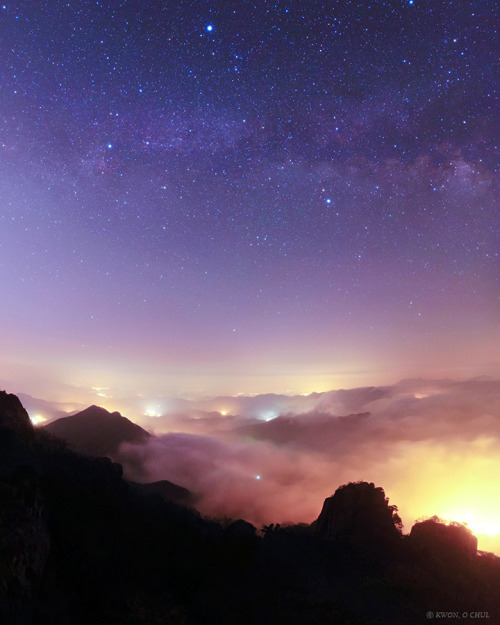 Summer Triangle above a Sea of Clouds      Site: Geumsan - Korea      The Milky Way and bright stars of the Summer Triangle shine above a sea of clouds covering nearby towns and villages in Geumsan County of the South Korea. The view is captured from Mount Daedunsan.      Credit: Kwon O Chul