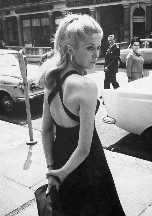 Catherine Deneuve on the street in an elegant dress, 1960s