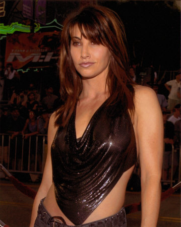 Look at that smirk. Gina Gershon is very sexy.