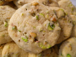 "gastromonstrosity:  Pistachio Shortbread Cookies Mardi Gras and St. Patrick's Day all in one month? AND it's almost SPRING! This calls for fatty, green spotted cookies! Ingredients: 1 1/2 cups all purpose flour 1/2 cup + 2 tablespoons powdered sugar 1/2 teaspoons salt (unless using salted pistachios) 1/2 cup chopped, roasted pistachios 3/4 cup butter, frozen, 1/2 inch cubes 3/4 teaspoon vanilla extract 1 egg yolk Whisk together flour, powdered sugar, and salt, then add in the pistachios, butter, vanilla, and egg yolk. Mix together well with hands or in a food processor. Roll into a log and wrap in plastic. Let chill in the refrigerator for at least one hour. Preheat the oven to 325 degrees F. Cut 1/4"" rounds from the log and place on an un-greased baking sheet, about 1/2 inch apart. Bake for about 18-20 minutes until light golden. Makes about 30, 1 1/2 inch diameter cookies. Happy March!"