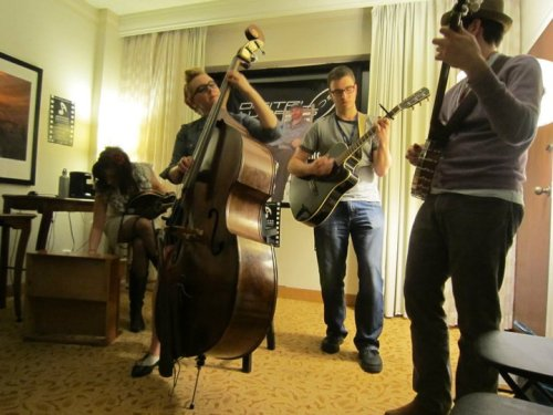 We found a picture that someone took of us jamming at Folk Alliance.  Thanks, someone!