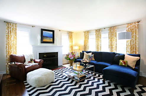 Amazing living room space filled with pops of yellow, and zig zag!