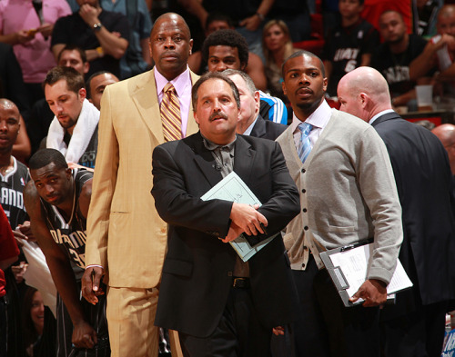courtside:  nbaoffseason:  Swag Van Gundy and his Posse: Patrick Ewing and Keon Weise  Editor's Note: I've said this before but Magic trainer Keon Weise has the illest cardigan game in the league (shots fired KG!). He's basically the anti-Stan. Every game he has a different sweater and pulls off the look rather effortlessly. Side sidenote: I see you, Earl Clark! (mark)  Yes! Keon Weise is finally getting the recognition he and his cardigans deserve. FYI ladies, he's married. What? I like to be thorough.