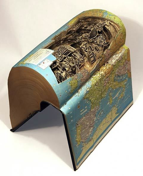 lostateminor:  Brian Dettmer uses outdated books, dictionaries and encyclopedias and carves them into incredible sculpture artworks.  With the help of knives, tweezers and surgical tools, he produces some of the finest book sculptures I have seen in a while. Dettmer is originally from Chicago, where he studied at Columbia College. He currently lives and works in Atlanta, Georgia. Original Article