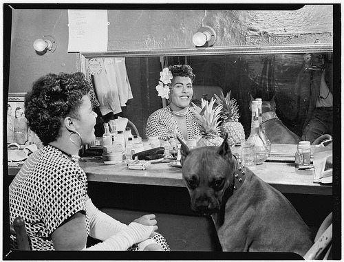 Billie Holiday and her boxer Mister in her dressing room, 1946.