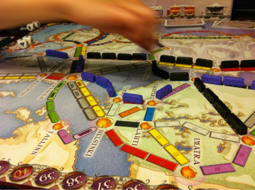 Game Night - Ticket to Ride: Nordic Countries (with the Dice Expansion)  I like using the dice on nights where we have a little less time. They really speed up the game, though you have to flex a house rule or two for the Nordic map. Dice rules favor quick route turnover over longer route buildup and add to the tension of route blocking. Also, for younger hands, the dice negate the need for card management which, in the traditional game, can be a challenge even for adults.