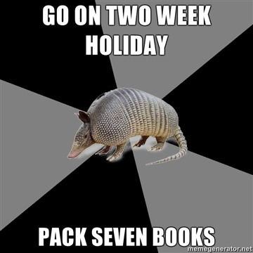 fyeahenglishmajorarmadillo:  Submitted by: milasweetlipskunis I'm home on Spring Break for a week….I brought three books….and my room has a whole bookshelf full of things I still need to read. O__O  I would pack maybe two books, one thick one and the other not so much. But I've got my Kindle now so life is good <33
