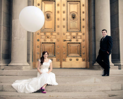Although this was a winter wedding, the bride's bright shoes and that fun balloon remind me that spring is coming! Photography by Elisabeth Kate Photography. Wedding featured on Style Me Pretty.