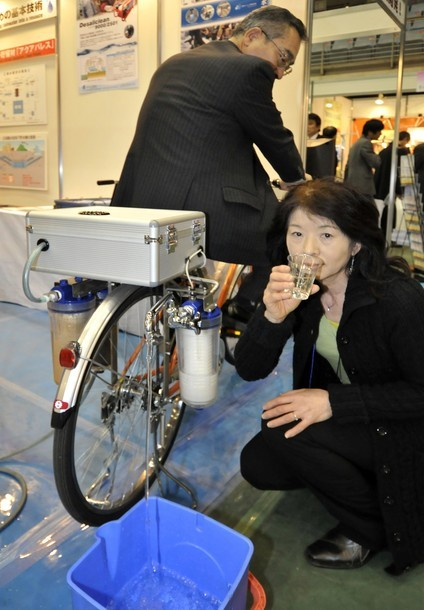 Japanese water purifier venture Nippon Basic displays a portable water purifying system, carried on a bicycle, 'Cycloclean, and powered by pedaling a bicycle to make a maximum of 5 liter of clean water in a minute at an environment-friendly technolocy fair in Kawasaki, suburban Tokyo on February 17, 2011. Nippon Basic is gearing up for a large-scale production of a bicycle in Bangladesh that can purify water at disaster areas and remote villages. (via Photo from Getty Images)