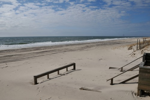 Boardwalk on Fire Island is buried in the sand after a winter of storms.