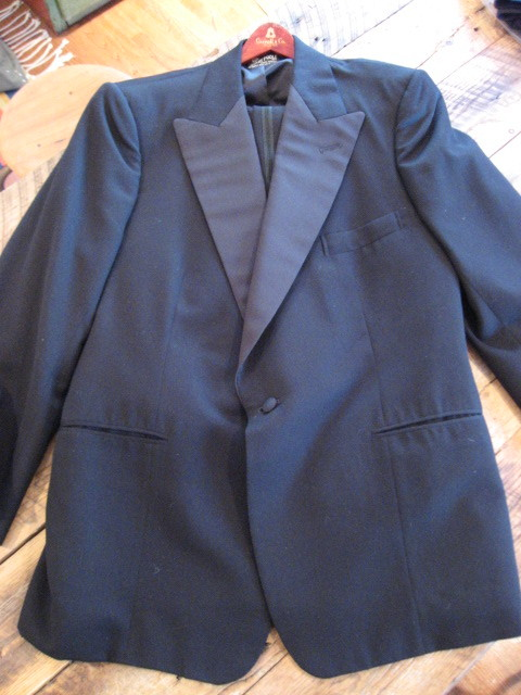 It's On eBay Henry Poole & Co. Tuxedo I couldn't believe my eyes when I saw this coat on the rack. Henry Poole? Really? But there were no trousers. That meant an absolutely frantic search through the pants rack… and paydirt.  Henry Poole & Co. invented the tuxedo in the late 19th century as a more casual dinner suiting for their client the Prince of Wales. After an American saw it and ordered one for himself, which he wore for dinner in the Tuxedo Club in New York, the tuxedo was born.  This thing is in perfect shape and it's absolutely beautiful. It's a couple inches short for my 42L frame, but if you're a 42R or maybe even a 42S, you could have a piece which cost $3000-4000 for a tenth of that. It's a piece you can genuinely wear for life. Starts at $390 on eBay