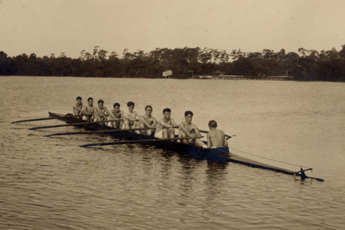 Rollins College eight posing on Lake Virginia in Winter Park, Florida. The nearest collegiate crew was Georgetown, 500 miles away