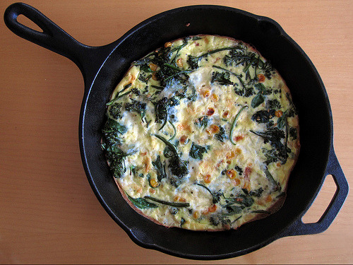 Another less egg, more veg (a.k.a. cleaning out the fridge) frittata.  I like this one because you can get all the ingredients at Trader Joe's, usually in close proximity to the demo station (a.k.a. free coffee).Roasted Corn, Garlic, Baby Broccoli, Spinach, and Smoked Mozzarella Frittata(adapted from Mark Bittman)Serves 2-4.  3 eggs1/2 c. milk1/4 c. smoked mozzarella, shredded3 garlic cloves, minced1 handful of corn (I used frozen)2 handfuls of baby broccoli2 handfuls of baby spinach Whisk the eggs, milk, and a little of the smoked mozzarella together in a bowl.  Preheat oven to 400º F.  Get a cast iron skillet (or other ovenproof pan) nice and hot.  Add a splash of olive oil to the pan, then the garlic, corn, and baby broccoli.  Cook for a few minutes, until everything looks nice and roasty.  Fold in the spinach, add salt + pepper to taste.      Pour in the egg mixture, cook just until the sides set.  Sprinkle the rest of the cheese on top and transfer the pan to the oven.  Bake until puffy and browned to your liking, about 10 minutes.