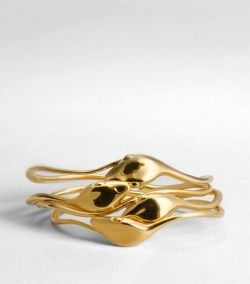 Snake bangles by Tory Burch