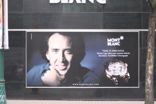 Nicolas Cage, with a mysterious full head of hair, was hawking watches on the side of this Hanoi building. (Scenes from Jacques and Liz's Asian Adventure)