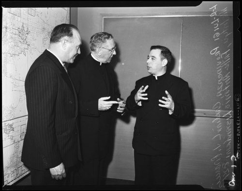 """Italian priest visitor, 24 August 1954.  Luigi Providenza (of San Francisco); Cardinal J. Francis McIntyre;  Father Antonio Lisandrini (at press conference)."""