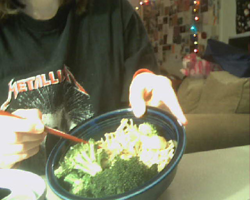 First meal at my new craft table! Also its weird that my webcam on my new laptop is too dark and this one, on my old laptop, is too light. -Topknot