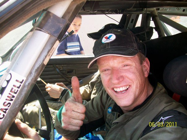 "So this week grassroots rally hero Bill Caswell returned to WRC Rally Mexico. The race didn't begin so well:  ""Hit jump at nearly 100 mph. Flew. Smashed the oil pan. Valvoline makes the best damn oil! I ran it dry for like 30 seconds and I think the bearings are ok still. I am patching the pan with JB weld and pieces cut from my skid plate. I am covered in JB weld. It's in my hair, under my fingernails, everywhere. I'm tired. I ran a stage, went to the super special to cheer for the other drivers, then fixed the car… four hours of sleep and we do it again. Until we break it worse that is. The car is toast. This might be its last race."" Highlights from the final day: ""Smashed the oil pan again on first stage. Also tore subframe out of the car as well. We filled it with oil before every stage and used the engine's vacuum at speed to keep the oil in. Best part? Our stage times were way fast. Supposedly we won the power stage and took like 30 seconds to a minute off the other cars. Oh yeah, we finished!"" His spirit was infectius and everyone—drivers, crews and spectators—can see how much fun he is having. A number of other teams have shown support by pasting Caswell stickers on their race cars and support vehicles. Bill and his Co-Driver at the podium ceremony (photo via Amado Galvan):"