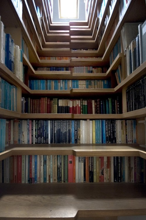 a bookshelf staircase?! too cool.