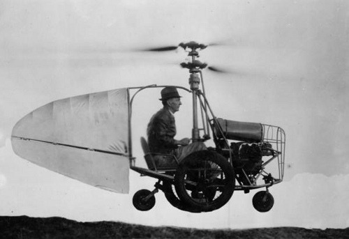 ckck:  Jess Dixon in his flying automobile, circa 1940.