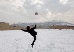 thebeautifulgameblog:  An Afghani boy attempts a bicycle kick in the snow.  Credit: Dar Yasin  best picture ever…