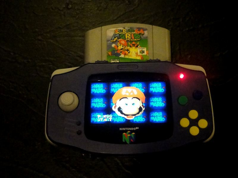 Dude Crams N64 Into A Game Boy Advance Carrying Case Shaped Like A Game Boy Advance. This was made by a dude calling himself hailrazer on the MODDEDbyBACTERIA forums. He stuffed the guts of an N64 into a comically large GBA case and, presto!, The N64Boy Advance was born. Click here for a video of the thing in action. [Via Engadget]
