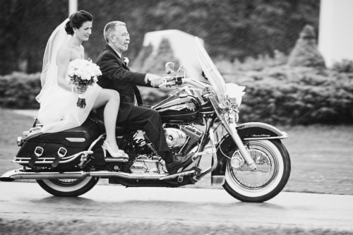 Bride rides Harley down the aisle in the rain.  135mm 2,  1/60 at f/2