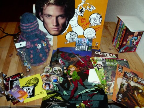 THE FIFTIETH POST! DALEK CULLEN ROLLS AROUND IN ALL YOUR SWAG. ALL YOUR COMIC SWAG IS BELONG TO M—THE DALEKS! Perhaps free, useless trinkets make kiss-happy roller skaters worth it? Why must humans do stupid things for useless material? Dalek Cullen does not want. No. Dalek Cullen wants it all.