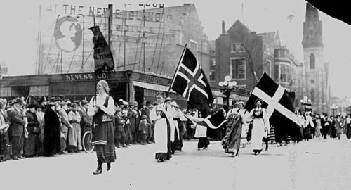 """Suffrage procession, Minneapolis; Scandinavian women in national costume with flags.  Photograph Collection 5/2/1914"" (photo via MHS Visual Resources Database) In honor the 100th International Women's Day."