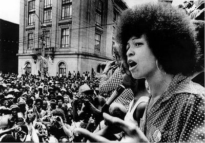 Angela Davis: One of Time magazine's MOST influential women in history  By the time Angela Davis was 26, she was a scholar, a political activist and a Most Wanted Fugitive of the FBI. Her roots as a leader during the political turmoil of the 1960s stretch back to her childhood in segregated Birmingham, Ala. After spending a year at the Sorbonne, Davis returned to a racially heated America. By the late '60s, she held membership in the Student Nonviolent Coordinating Committee, the Black Panther Party and the American Communist Party. Her militant involvement cost her a UCLA lecturer position when the California regents learned of her affiliations in 1970. However, Davis' activism continued with her support of three Black Panther inmates at Soledad State Prison. At their trial, for a prison guard's murder, a botched kidnap and escape attempt resulted in the death of a federal judge, Harold J. Haley. Davis was accused of supplying the guns. She fled, sparking a furious manhunt and landing her a spot on the Most Wanted list. While she was on the run, a movement advocating her freedom flourished. Davis was caught in New York but was acquitted in 1972. Despite the agitation of then California Governor Ronald Reagan, she resumed her teaching career at several universities in the state and is now a professor emerita at the University of California, Santa Cruz. She has authored several books, including Women, Culture and Politics (1988) and Are Prisons Obsolete? (2003).