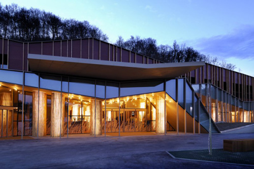 Today's editor's pick is a low-slung hotel in Slovenia, whose exterior paneling and ground-hugging shape references the surrounding forest.