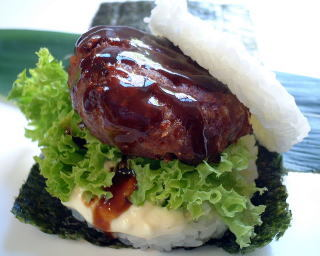 Cheap eat of the week!  Sushi Burger. This culinary delight is a little slice of heaven! Conveniently located beside The Elephant and Wheelbarrow pub on the corner of Bourke and Exhibition Streets in Melbourne's CBD, J Sushi Burger, don't blink or you'll miss it, is a fabulously unique. Two rice patties replace the bun of a 'normal' burger, hinged together by a rectangular sheet of seaweed. With loads of delectable options to choose from on the menu, sushi burger's are great value for money and offer both eat in or take away! -Celeste