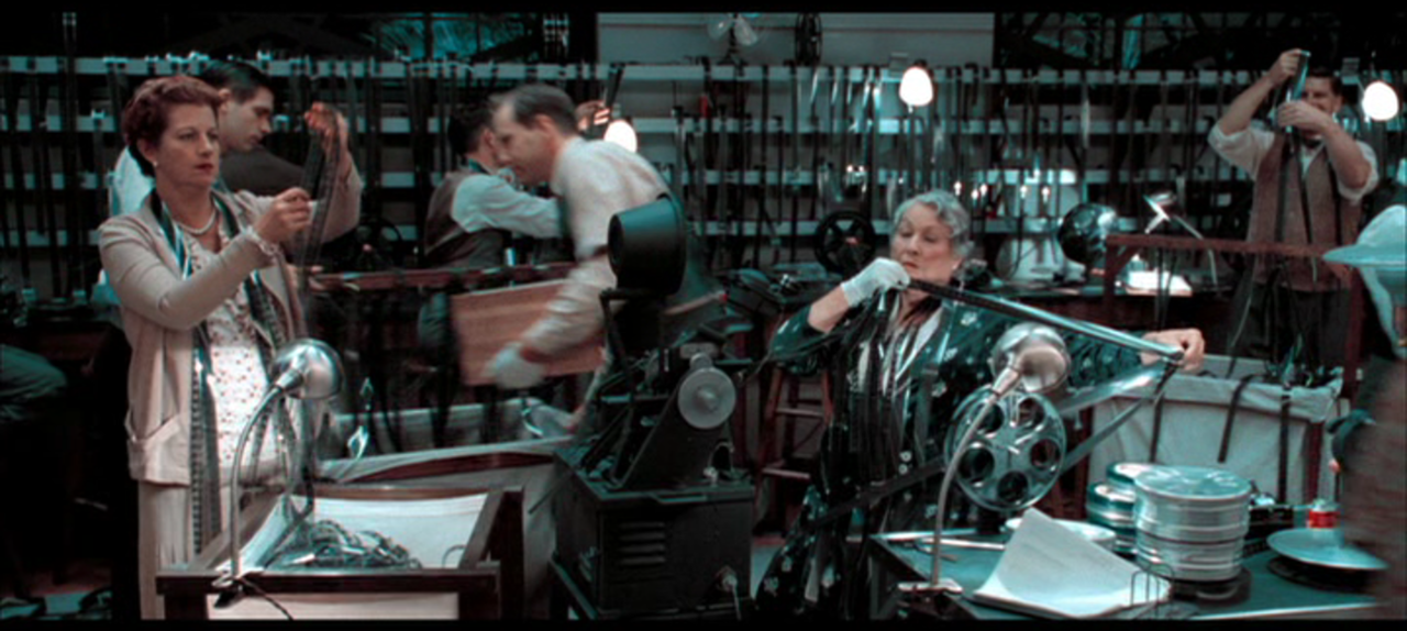 Anne V. Coates (seated at right) cameos as one of Howard Hughes's many editors in The Aviator.